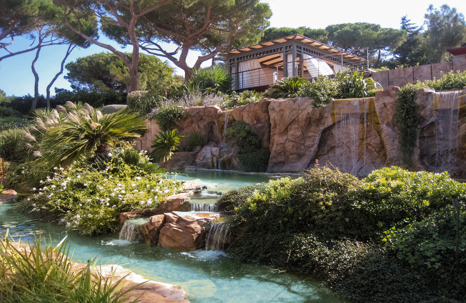 Fishpond with waterfall and landscaped supporting walls